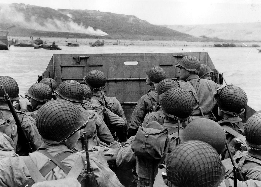 Assault troops in an LCVP landing craft approach Omaha Beach, 6 June 1944.