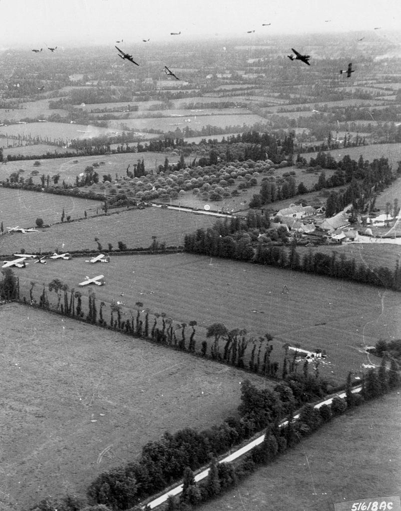 Gliders are delivered to the Cotentin Peninsula by Douglas C-47 Skytrains. 6 June 1944.