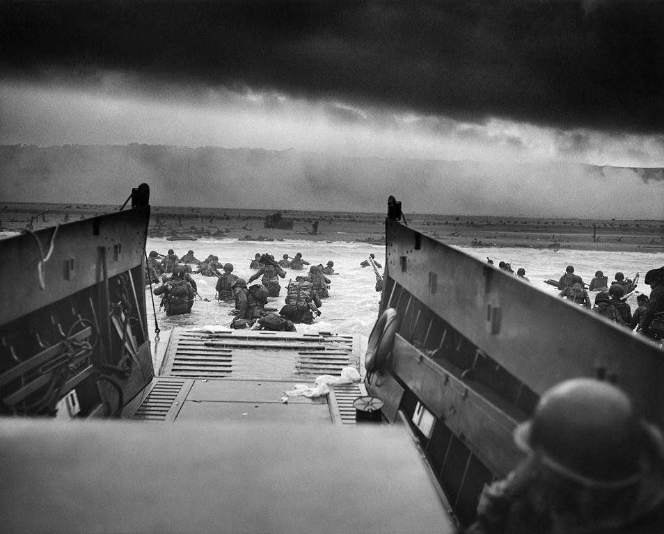 Men of the 16th Infantry Regiment, U.S. 1st Infantry Division wade ashore on Omaha Beach on the morning of 6 June 1944.