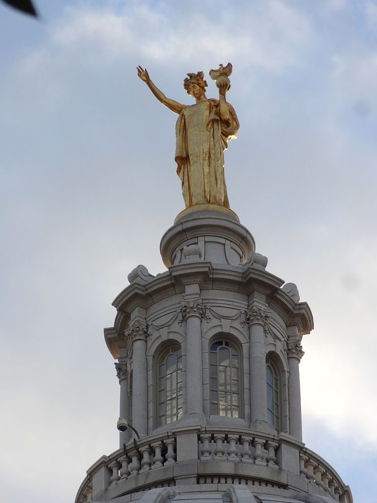 """""""Wisconsin"""" on top of the Wisconsin Capitol Building created by Daniel Chester French."""